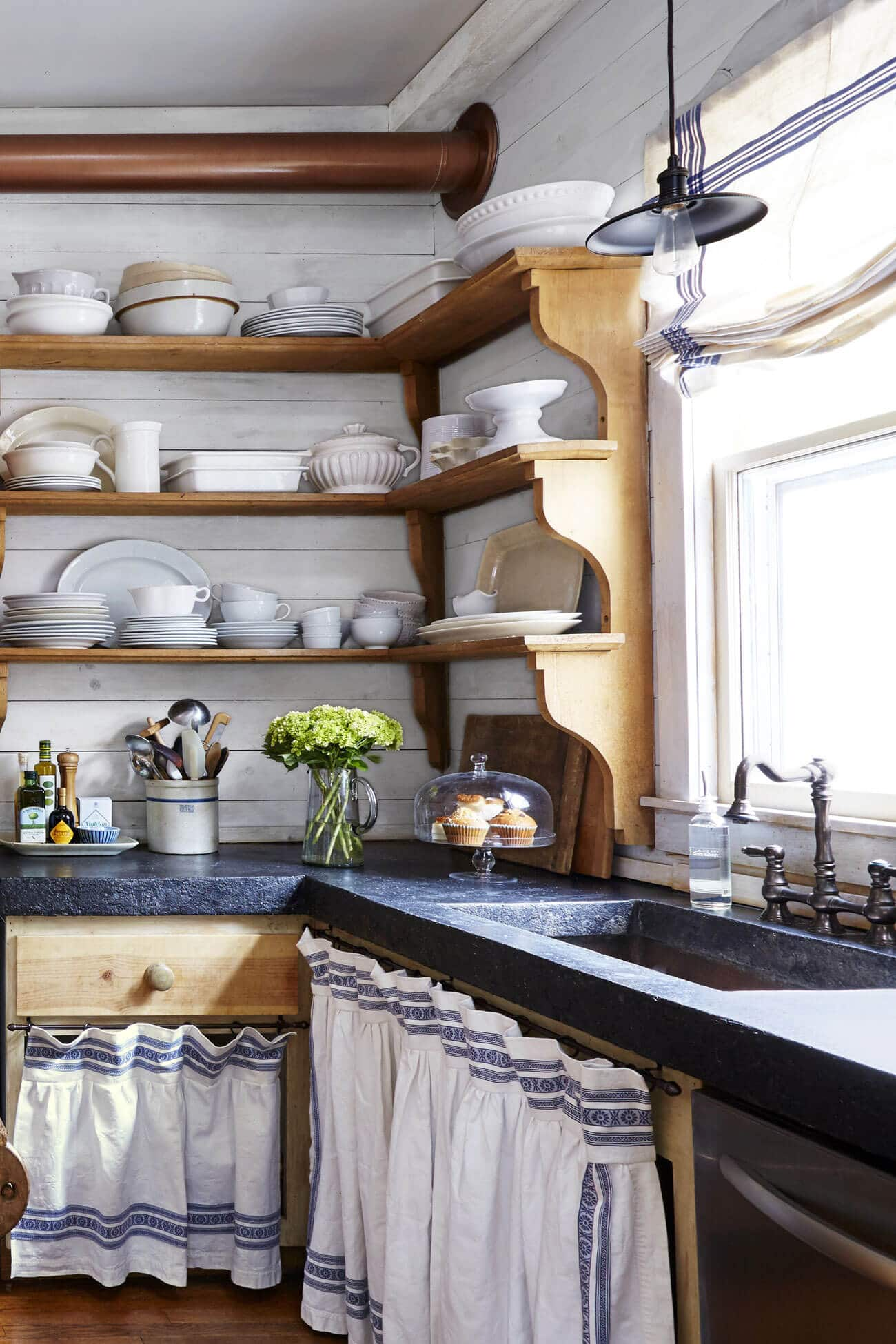 Blue and White Linen Curtains with storage shelves with dishes