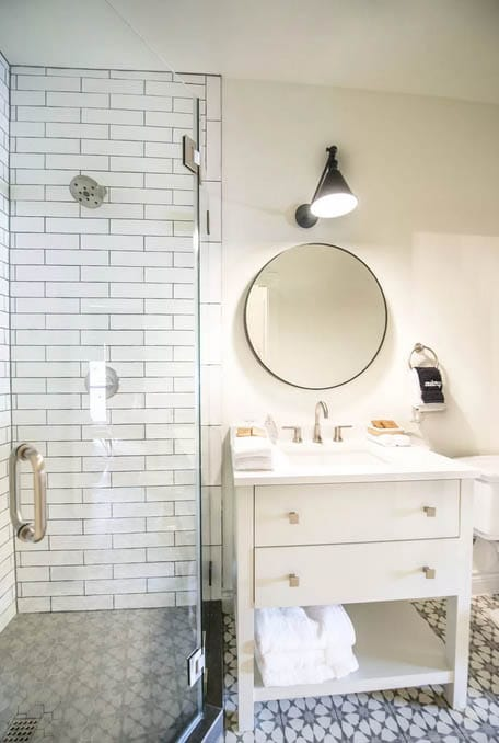 Brass Shade Pendant as rustic bathroom lighting ideas with round mirror and vanity sink in white