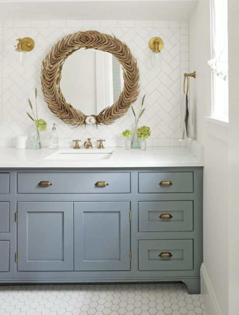 Brass and Glass Sconces rustic bathroom lighting ideas with accessories and light grey sink with round mirror