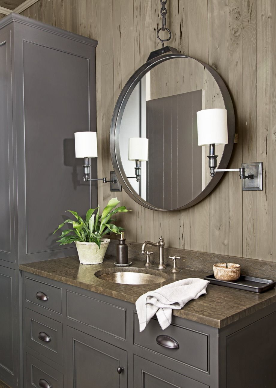 Bronze Sconces with White Shades with rustic bathroom lighting ideas in brown dark tones with large round mirror