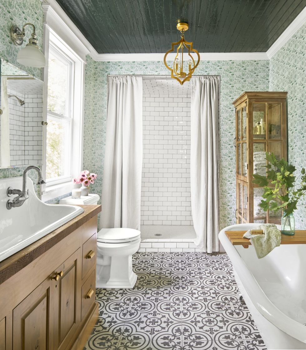 Brushed Gold Pendant in bathroom with green wallpaper wooden storage cabinet and retro floor tile