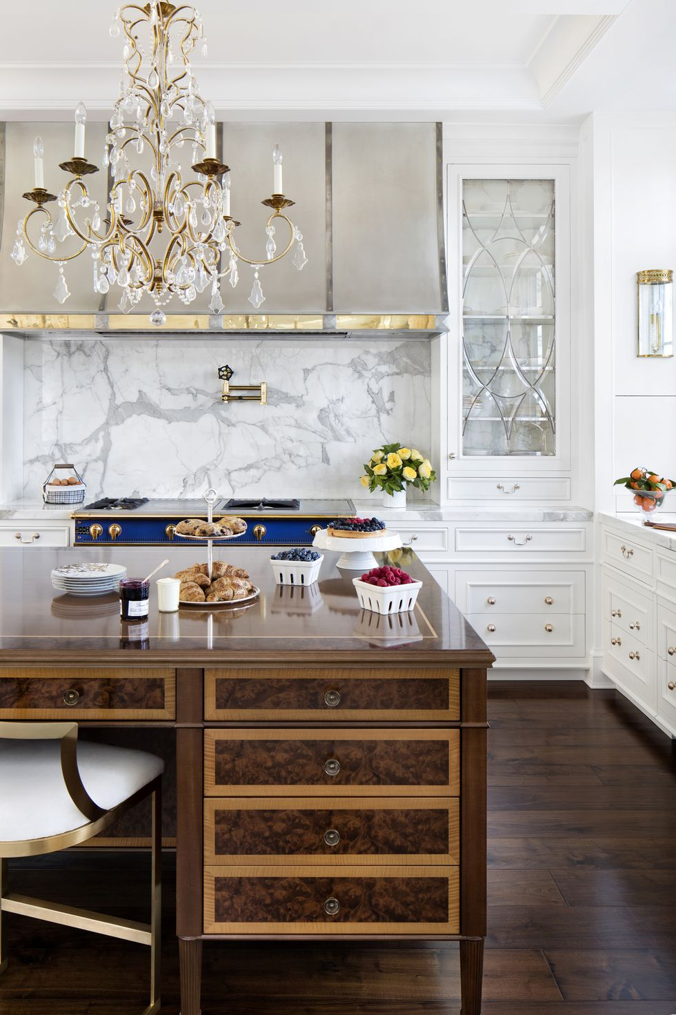 English kitchen in white with chandelier wood floors and marble wall
