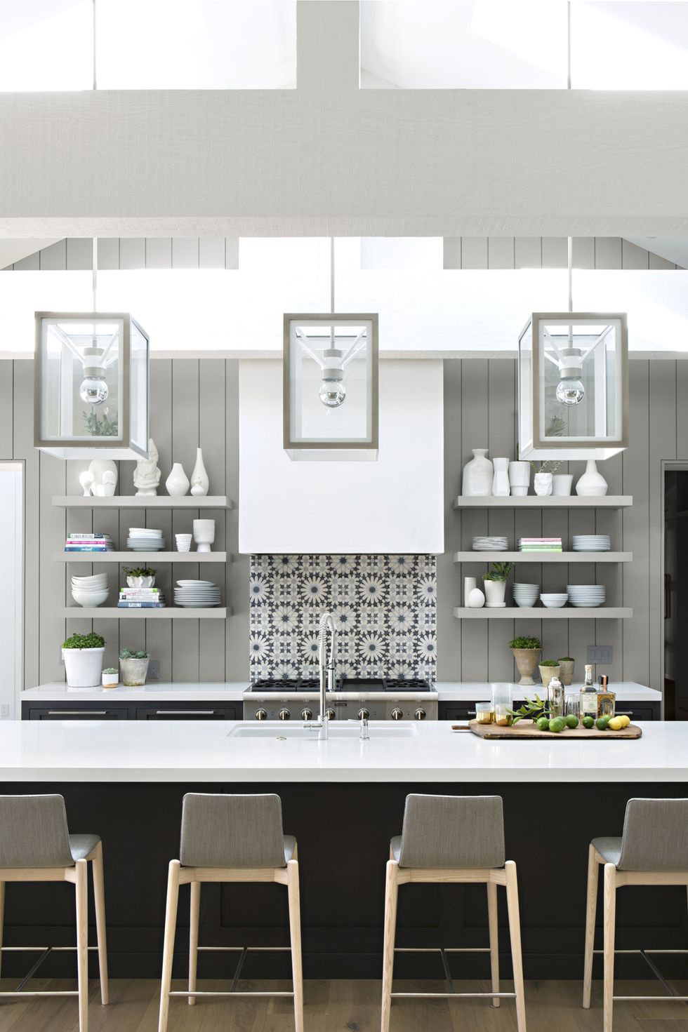 Gray kitchen with light countertop and shelves with lighting