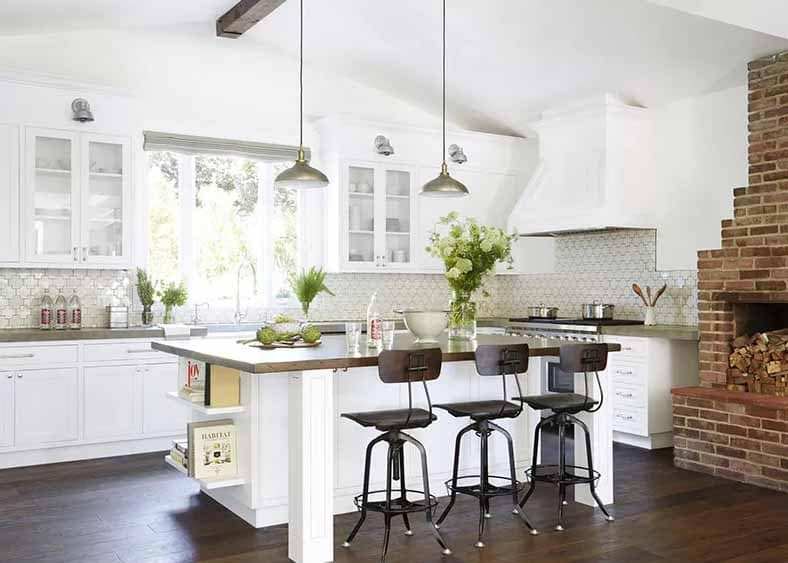 Concrete Countertops in white kitchen with brick fireplace