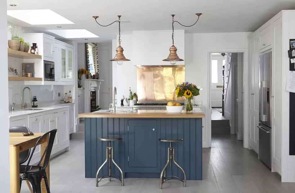 Copper Light Fixtures and Industrial Accents cabinets in blue and white Modern Farmhouse Kitchen Ideas