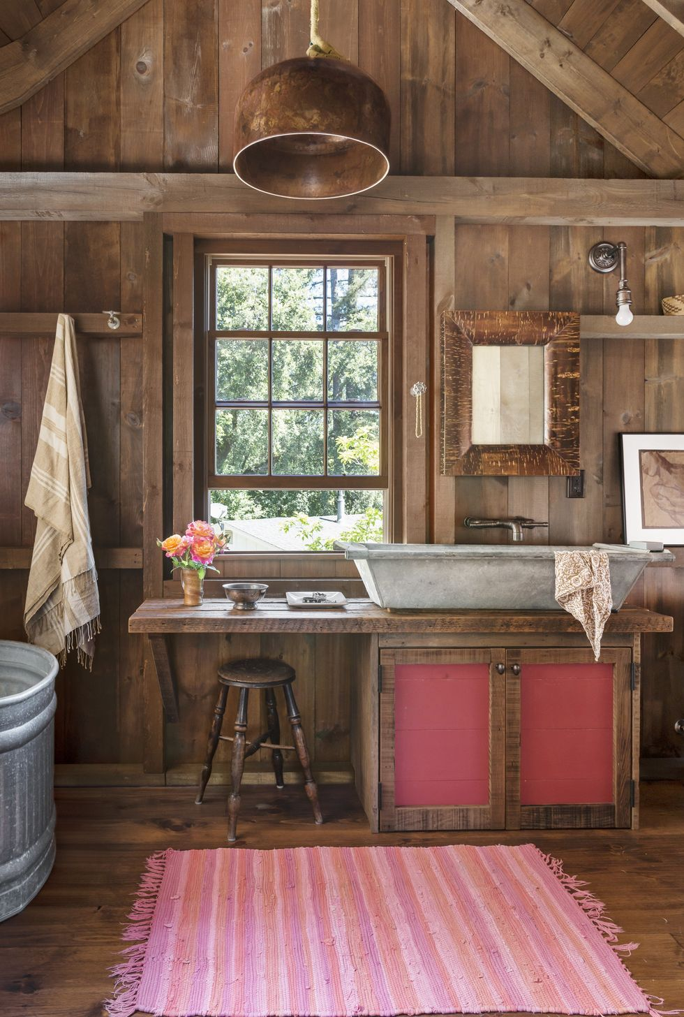 Copper Pendant in rustic bathroom lighting ideas in wood bathroom with large square window