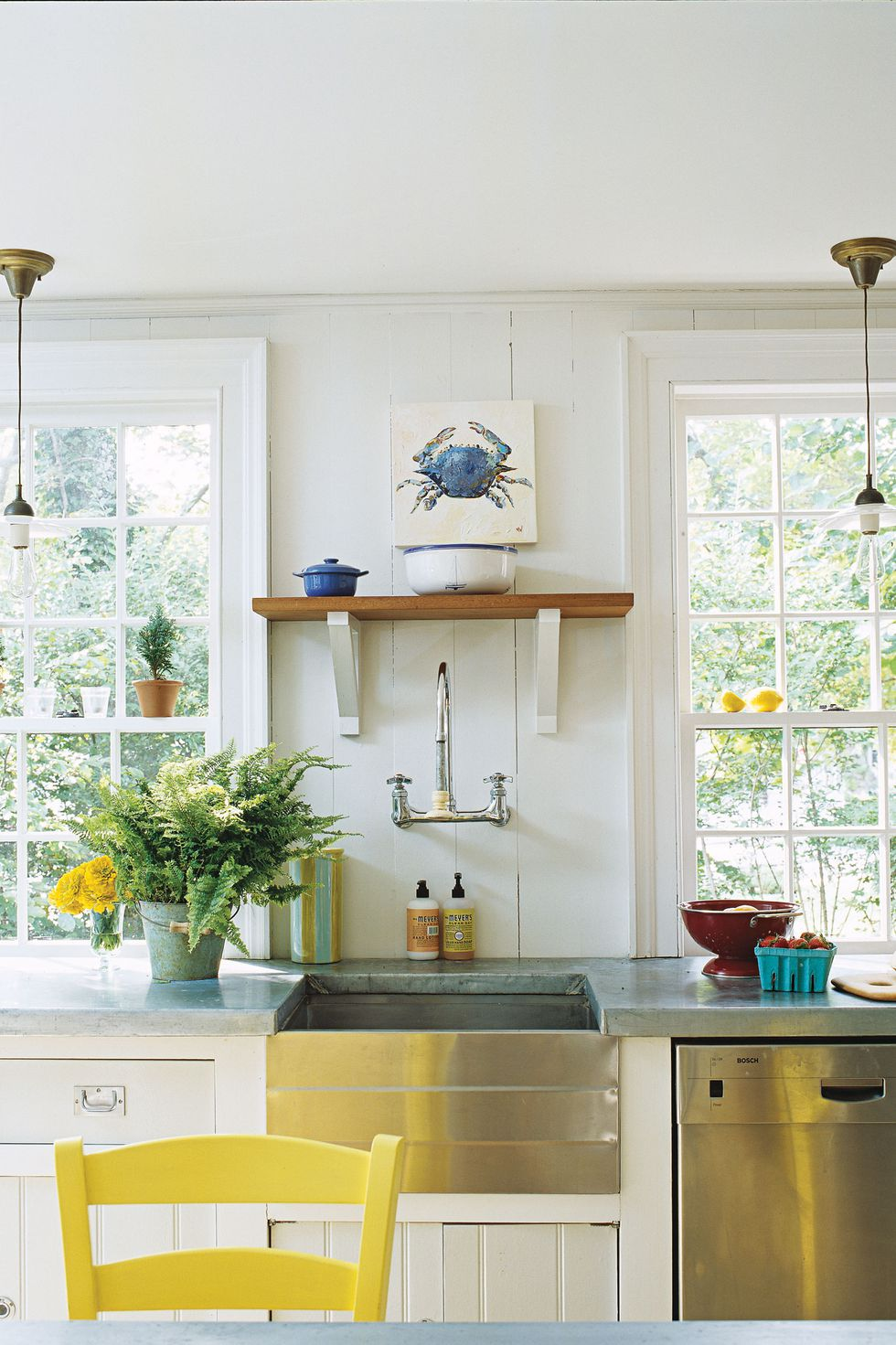 Kitchen countertop with flowers and yellow chair with wooden shelf