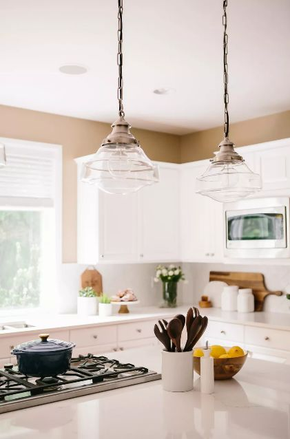 Kitchen decorating ideas for countertops in white kitchen with brown walls