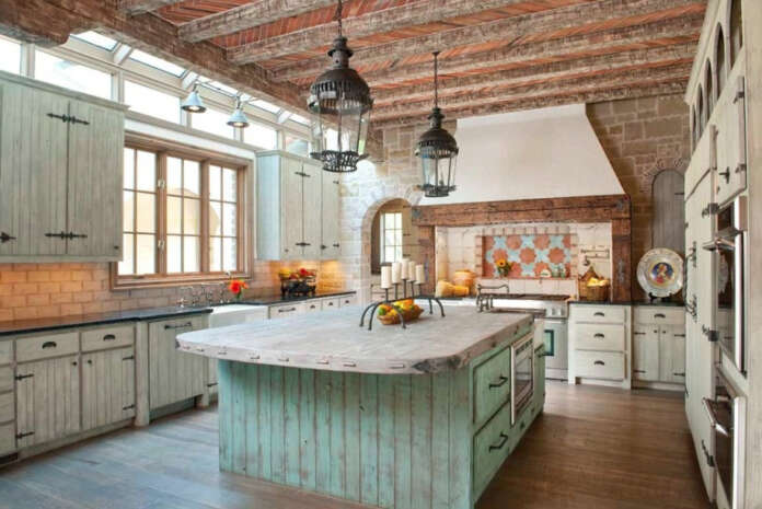 Exposed Wood Beams in Modern Farmhouse Kitchen Ideas with large lamps and wood flooring