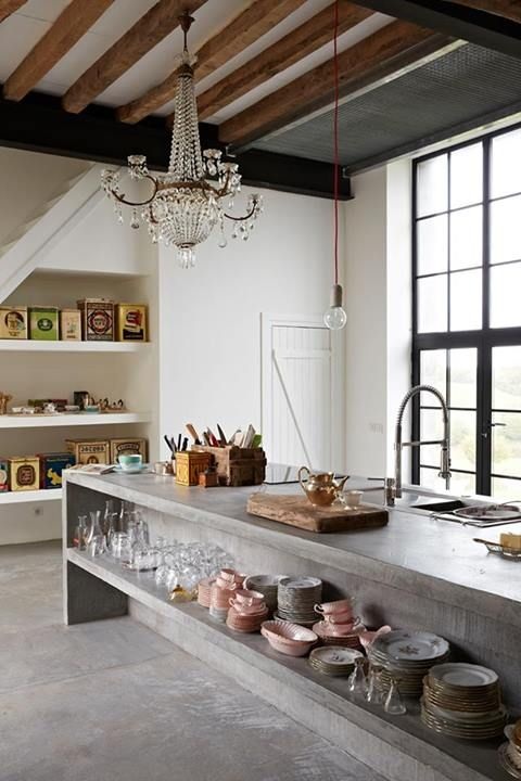 Farmhouse kitchen with concrete countertops and chandelier with open beam ceiling
