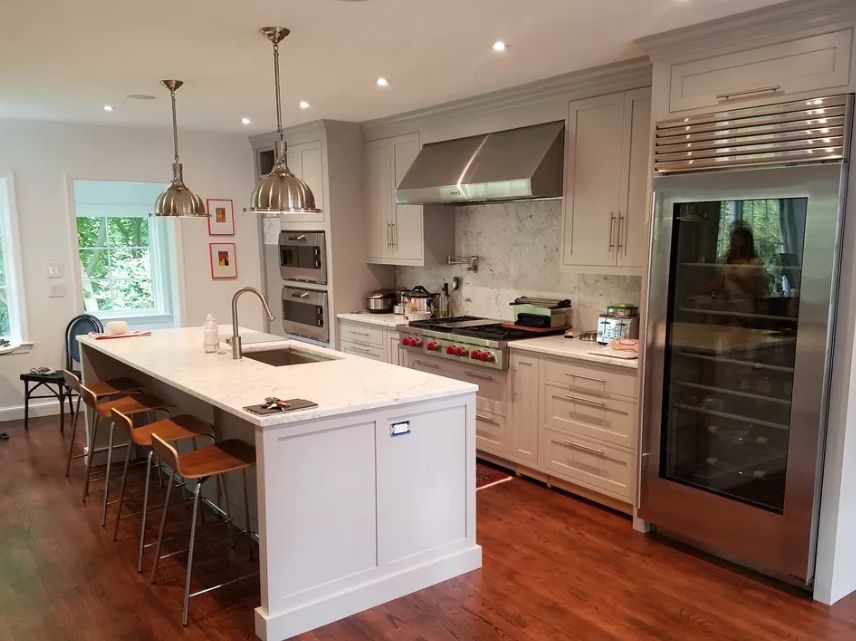 White kitchen decorating ideas for countertops with metal accents with wooden floors