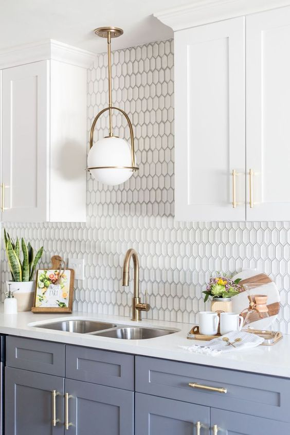 Kitchen decorating ideas for countertops with beehive backsplash and gray cabinets