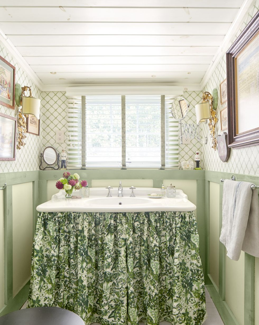 Gilded Sconces rustic bathroom lighting ideas in light green bathroom with floral accents