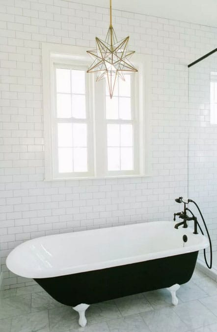 Rustic bathroom lighting ideas in white bathroom with glass star pendant and tub