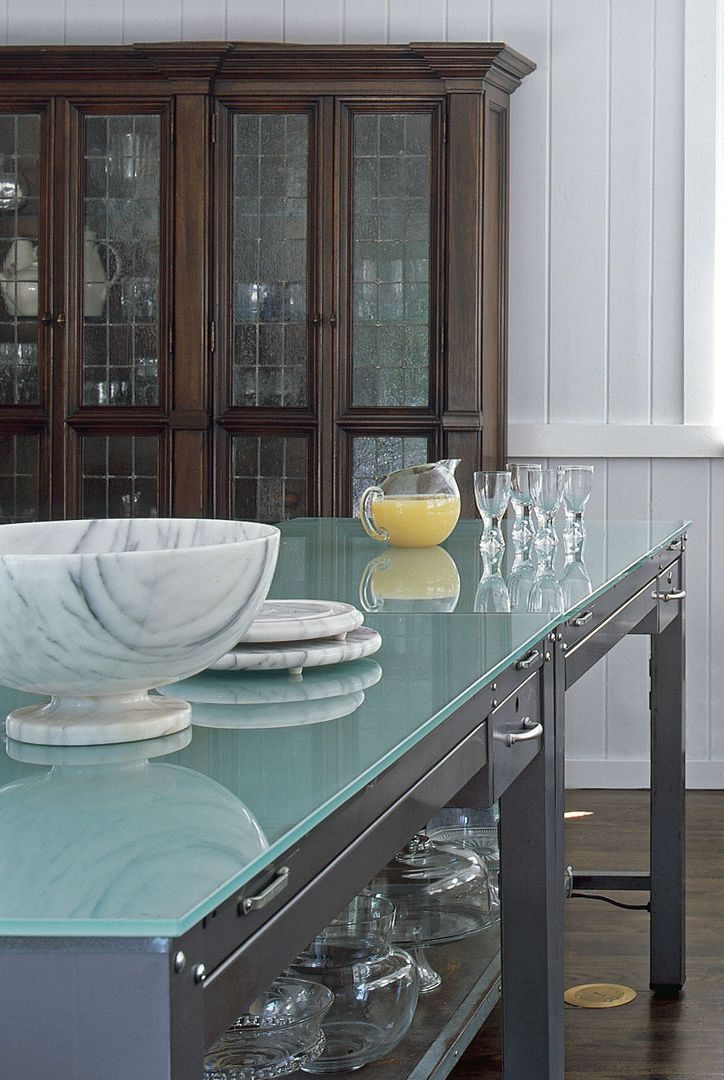 Glass counter in kitchen with brown cabinet and glassware