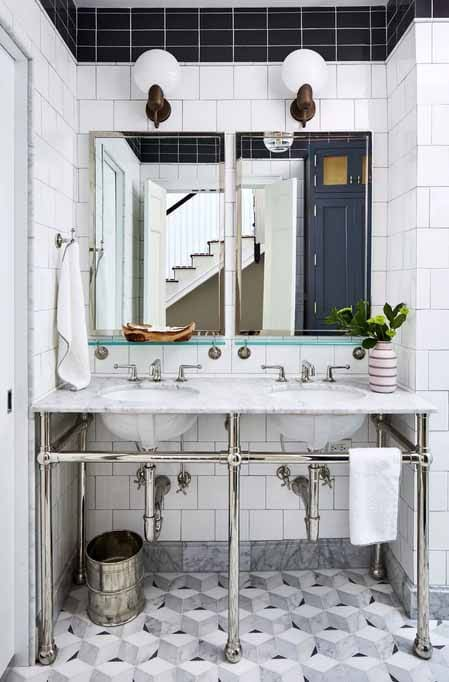Globe Pendant Lights as rustic bathroom lighting ideas in white tile and metal accents on double vanity sink with mirrors