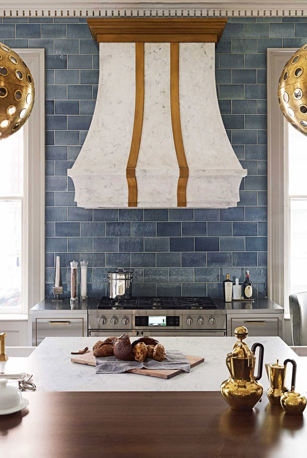 Wood copper and bronze accent kitchen with blue backsplash