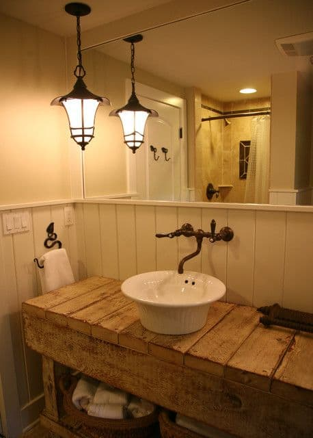 Iron Pendant Lamp in white bathroom with rustic sink and wood shelf