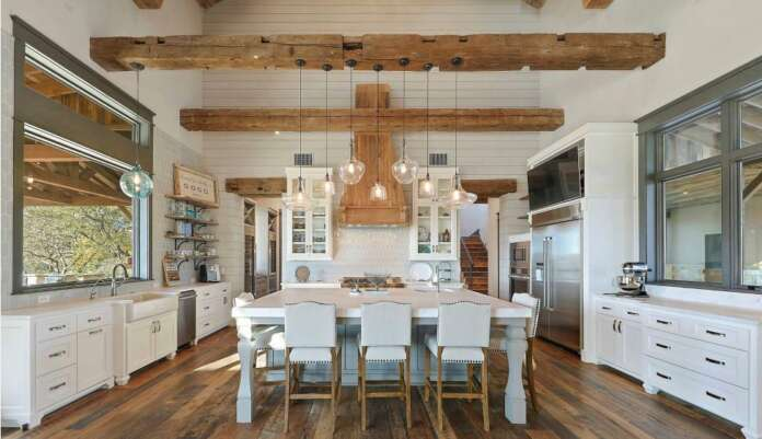 Low Beam Modern Farmhouse Kitchen Ideas with lighting and wood flooring