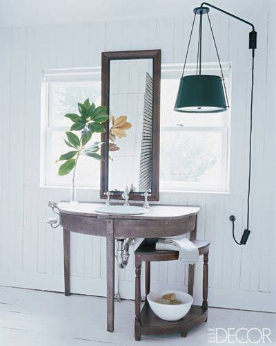 Low hanging lamp in white bathroom with rustic bathroom lighting ideas with sink and mirror