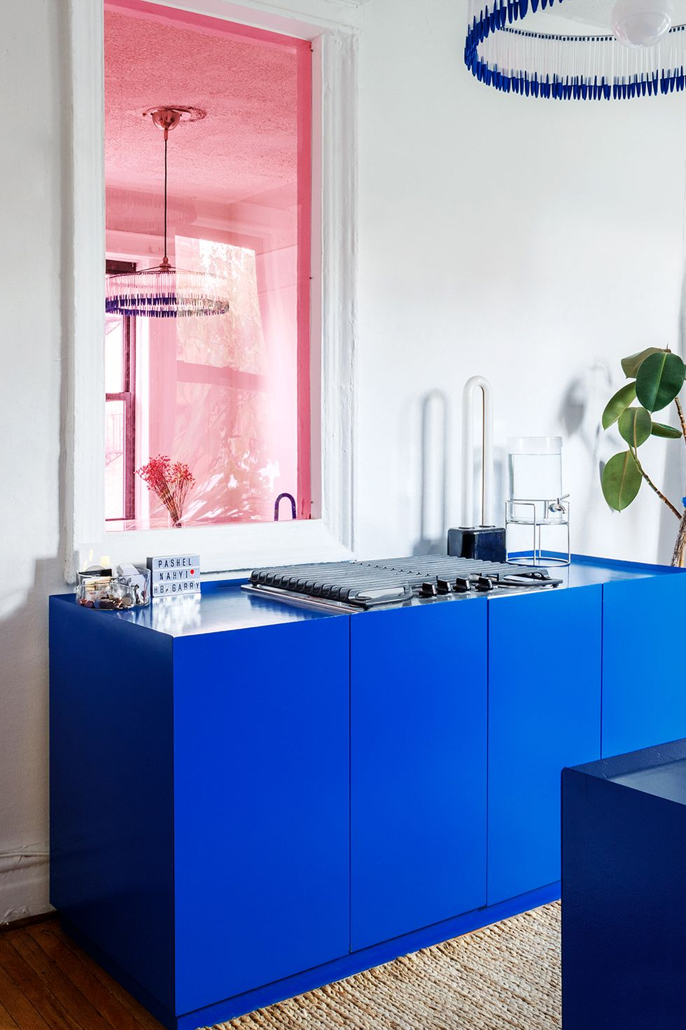 MDF countertop in blue in white kitchen with decor