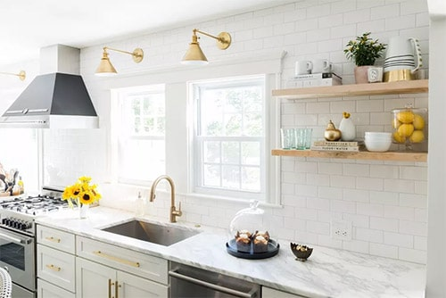 Mix of Metals kitchen cabinet in white with shelves