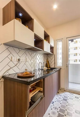 Morrocan Tiles with blacksplash and open cabinets