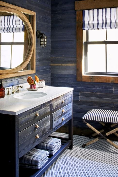 Nautical Sconces with rustic bathroom lighting ideas in dark blue highlights with wood accents and large mirror