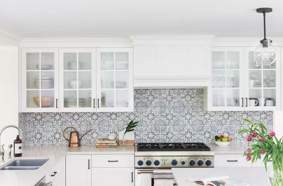 Kitchen decorating ideas for countertops with cookbooks patterned backsplash and other decor in white
