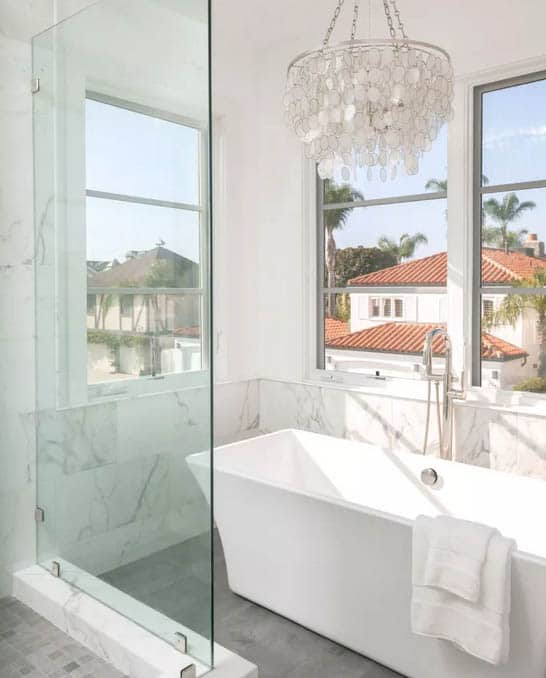 Pearl Chandelier with rustic bathroom lighting ideas in white bathroom and lots of natural light