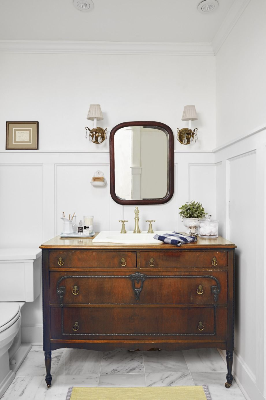 Pleated Shades and Crystal Sconces with rustic bathroom lighting ideas with accessories in white bathroom