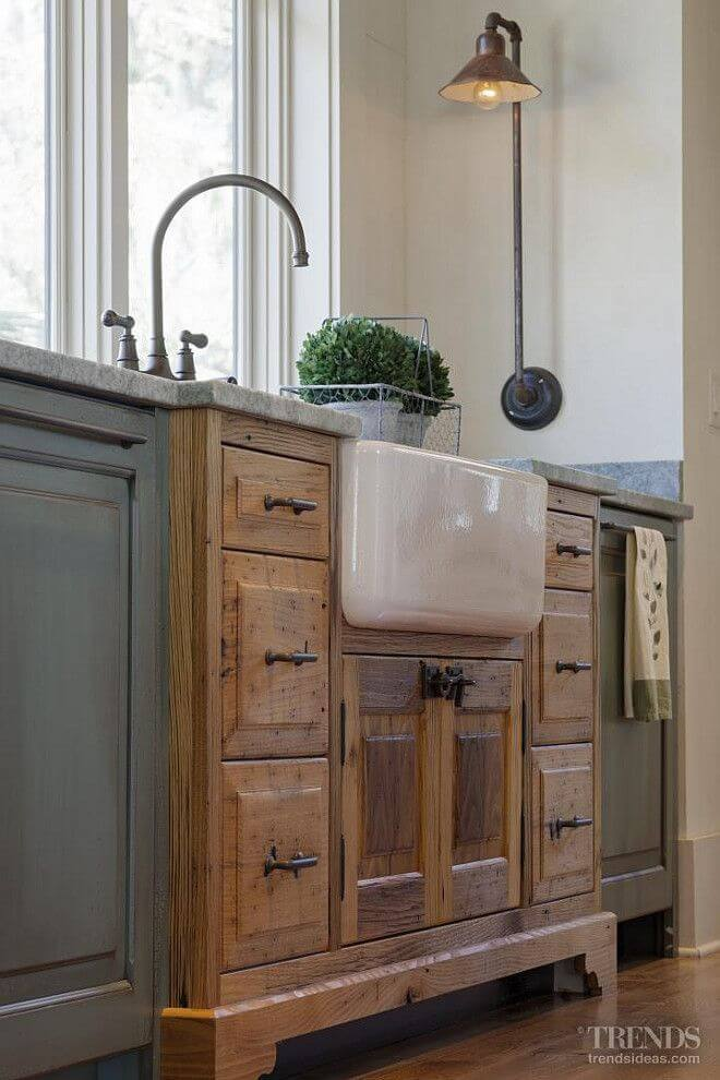 Porcelain Sink in kitchen with light and plant