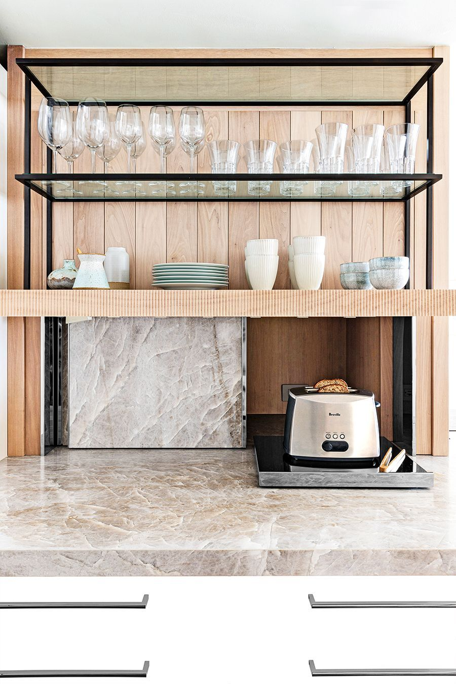 Quartzite countertop with shelves and glasses with wood background