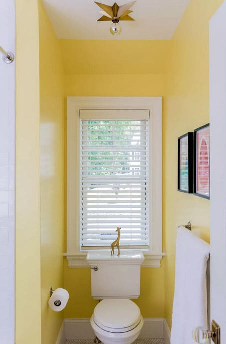 Retro Star Shaped Light with rustic bathroom lighting ideas in yellow bathroom with artwork