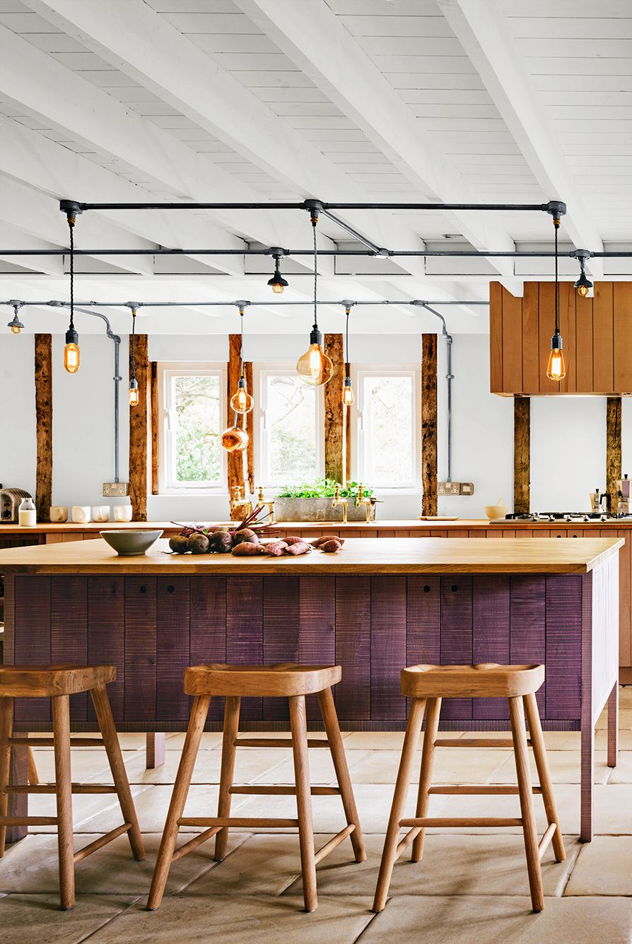 Sanded and Oil Stained Oak countertops in kitchen with rustic lighting and wood accents