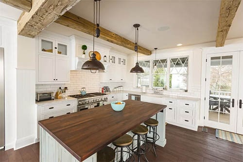 Shaker Cabinet with wood accents in white with Modern Farmhouse Kitchen Ideas