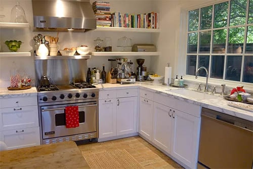 Terra cotta tiles with books and shelving in white cabinets