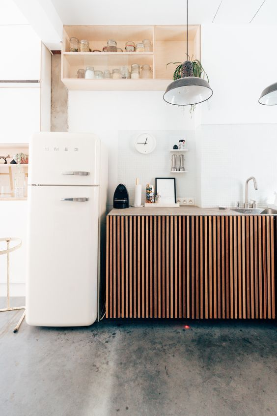 Kitchen decorating ideas for countertops with small fridge with storage shelves and lighting