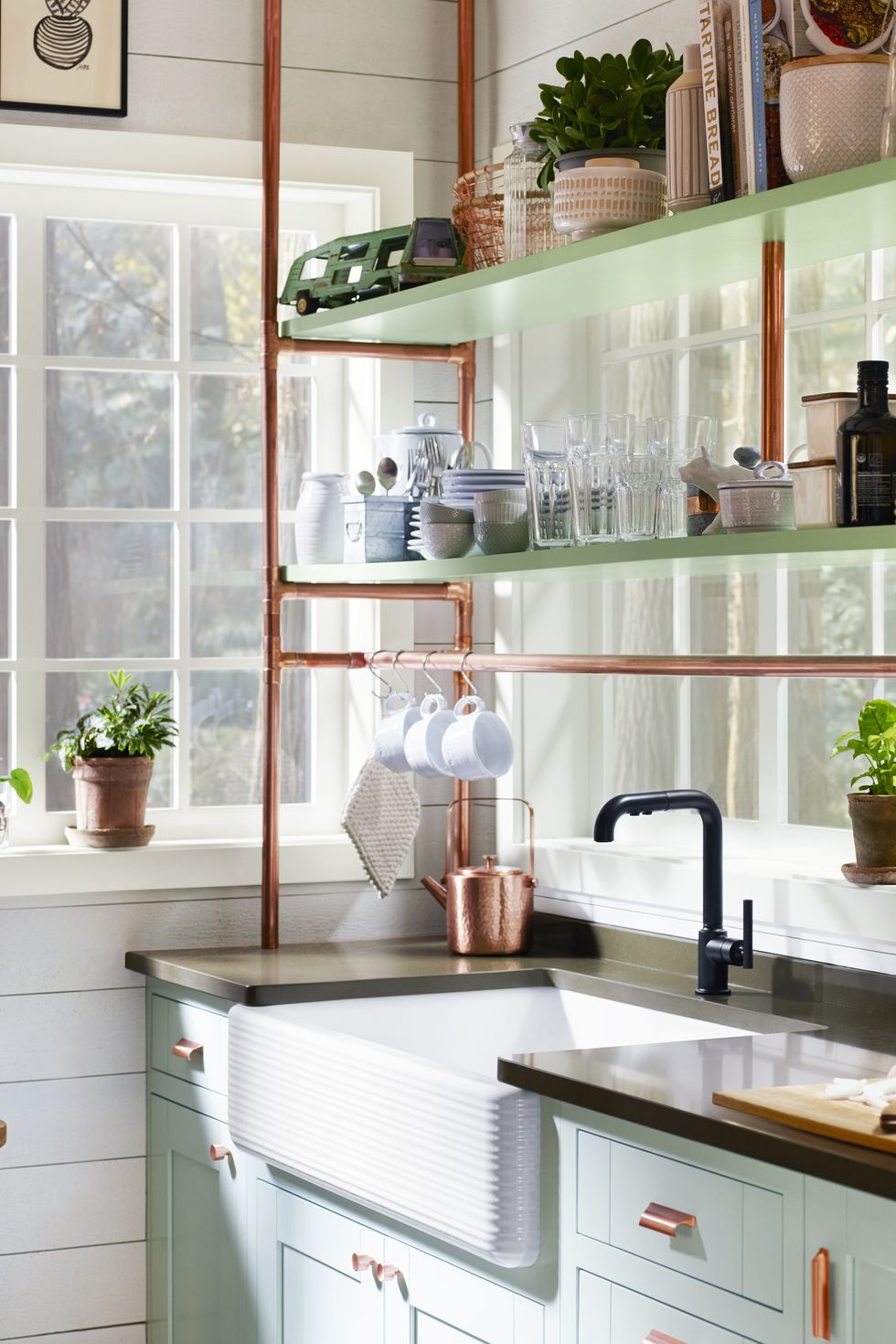Kitchen decorating ideas for countertops with copper tubing shelves and cups
