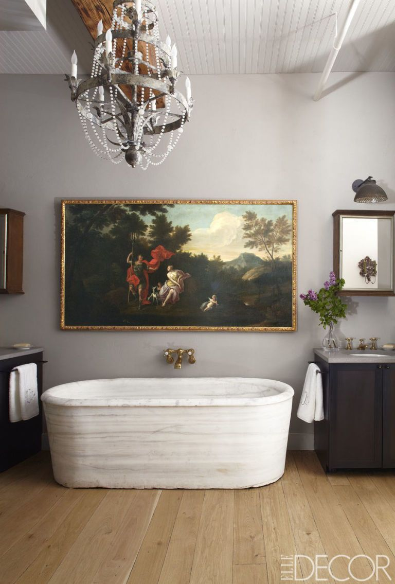 Rustic bathroom lighting ideas with Vintage Italian Chandelier and large painting in white bathroom