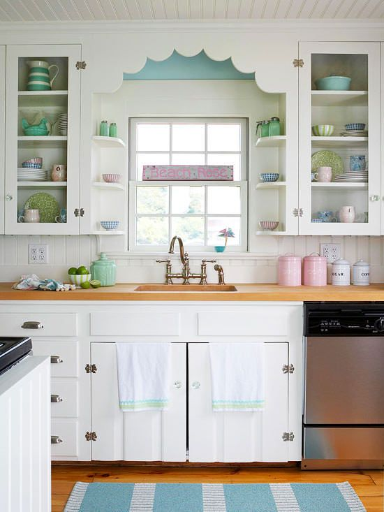 White Painted Glass Cupboard Doors with pastel cups and plates