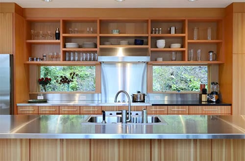 open shelves in kitchen with metal countertop and wood accents