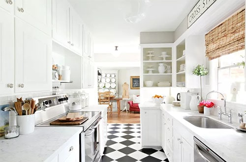 retro flooring in white kitchen with white cabinetry