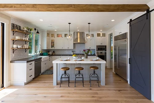wood flooring with island shelving and large island Modern Farmhouse Kitchen Ideas