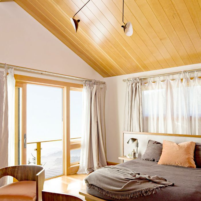 Feng shui room with wood ceiling and large open sliding window