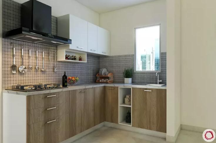Wood kitchen with medium tones and shelving with hanging utensils