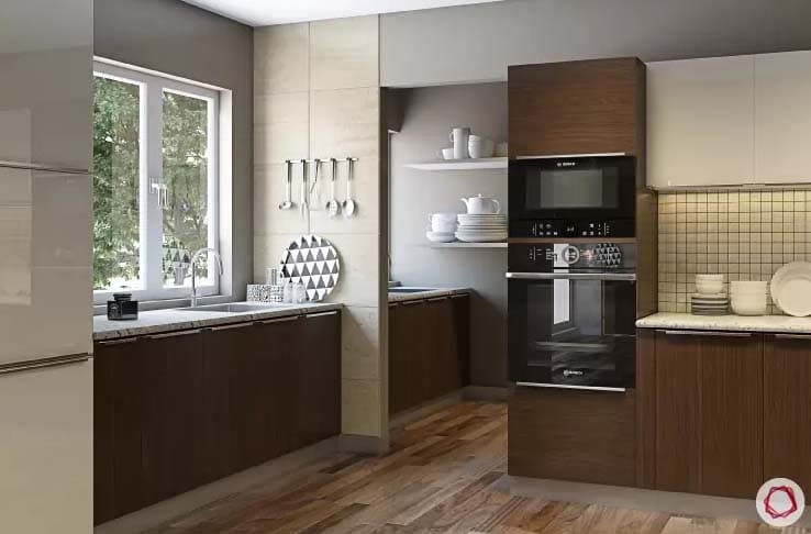 Wooden flooring in kitchen with white and gray tones with large window