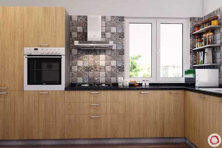 Wood cabinets in kitchen with unique backsplash and black countertops