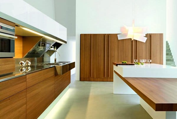 Kitchen design with light floors and white walls and metal appliances