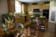 Wood kitchen design ideas with lighter cabinets and plants